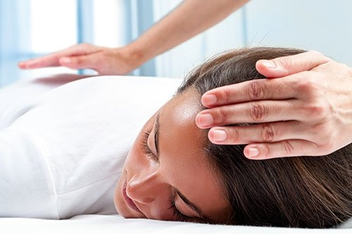 Therapists Hands Doing Reiki Therapy On Girl.