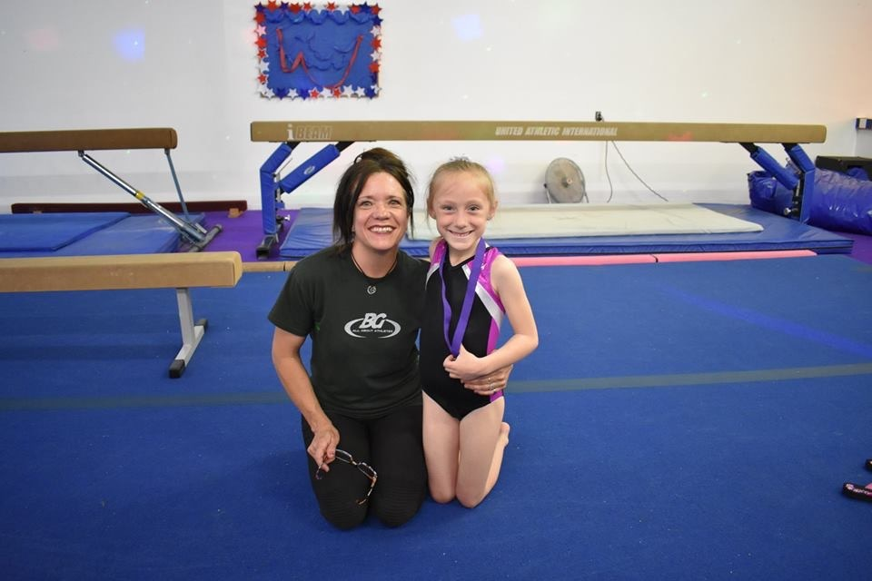 Gymnast With Expert Coach