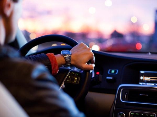 Professional Driver Driving a Car