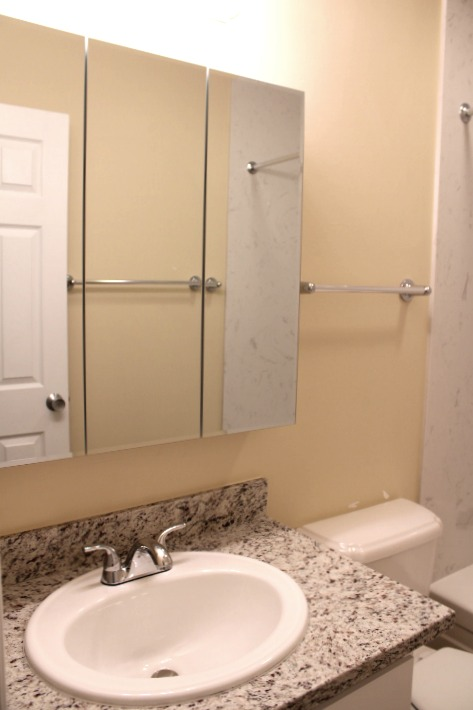 The bathroom has a new, granite countertop and new vanity cabinet!