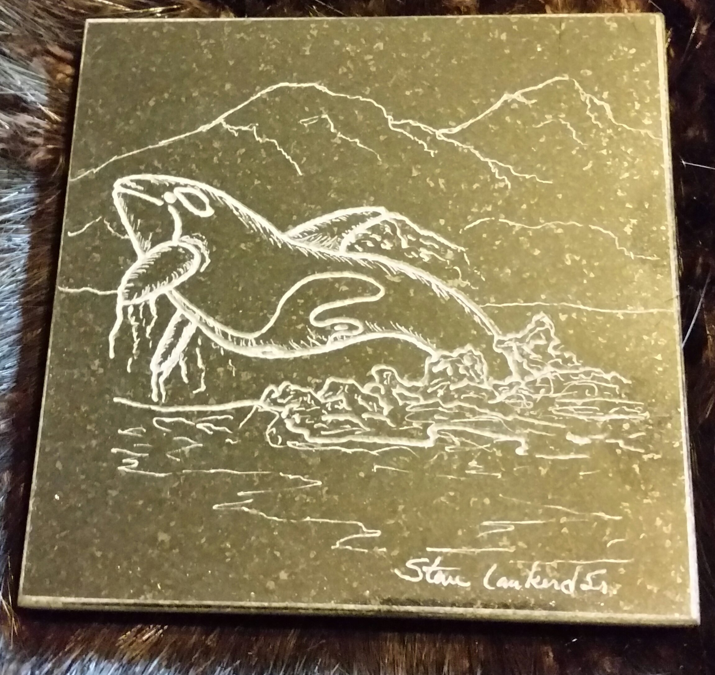 Hand engraved killer whale on a granite coffee coaster...  $25.00