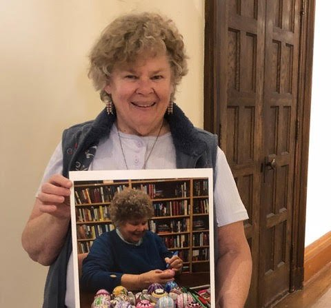 Photo of Sr. Sandy Schadewald with hand painted eggs.