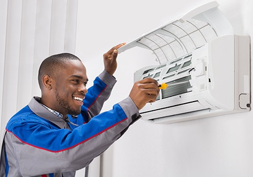 Technician Repairing Air Conditioner