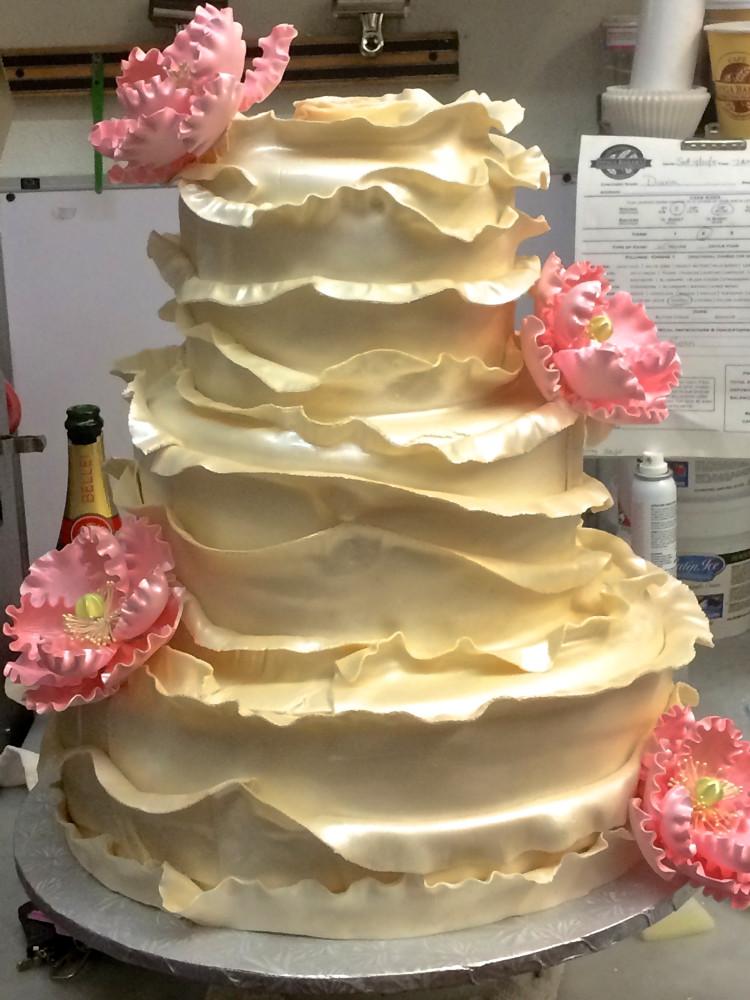 Ruffled Wedding Cake with Flowers
