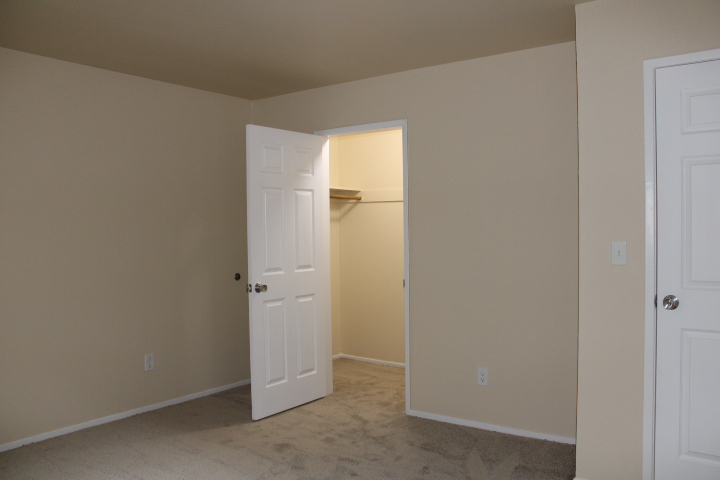 The bedroom and walk-in closet have new carpet.