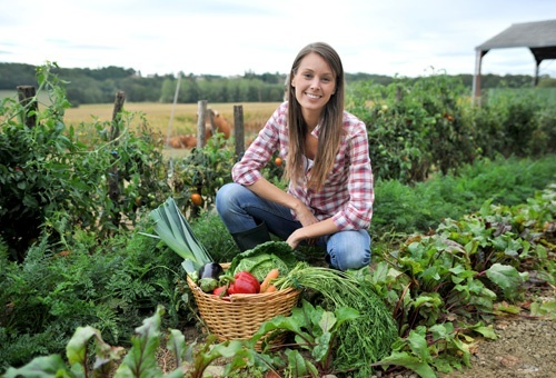 Woman Knelt In Vegetable Garden