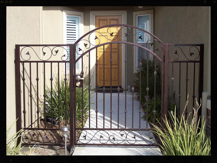 IRON COURTYARD GATE WITH ITALIAN LEAF SCROLLS TOP AND BOTTOM