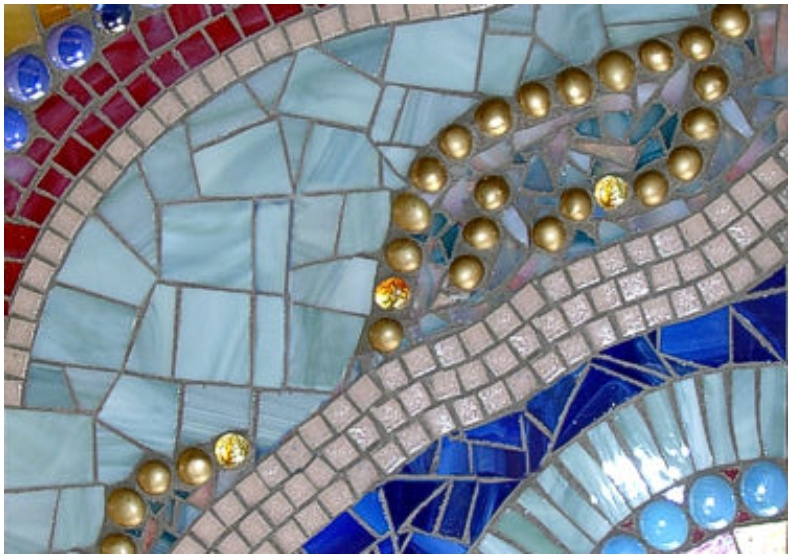 $550 - $699 / Sq. Ft. Much more difficulty in design. Glass, ceramic tiles, gems & marbles combined.
