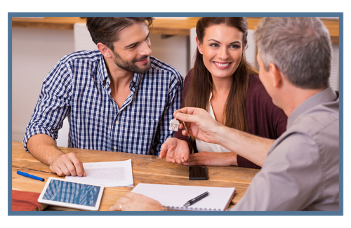 Couple talking with insurance agent