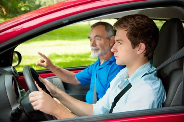 Driving student with trainer