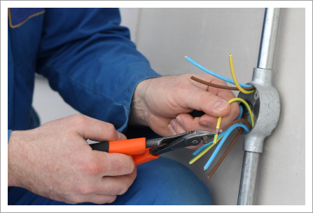 Electrician preparing cables for connection||||