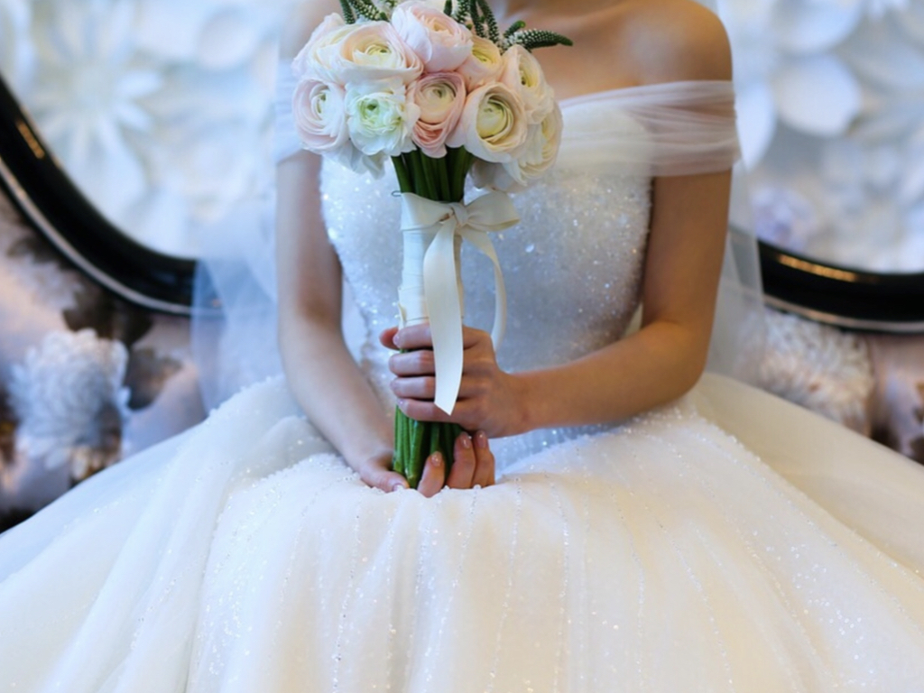 Bride with bouquet on wedding day
