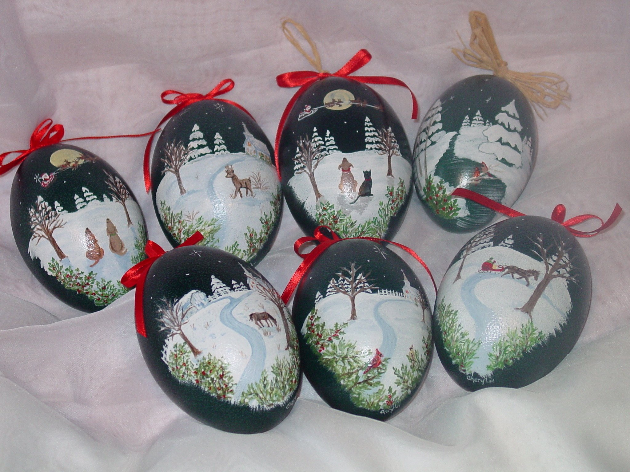 Holiday Painted Emu Eggs - Emu eggs are these lovely blue-green color. The hand paintings are covered with shellac to preserve the paintings for years to come, so they can be displayed each holiday season.