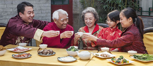 Asian Family Sharing a Toast