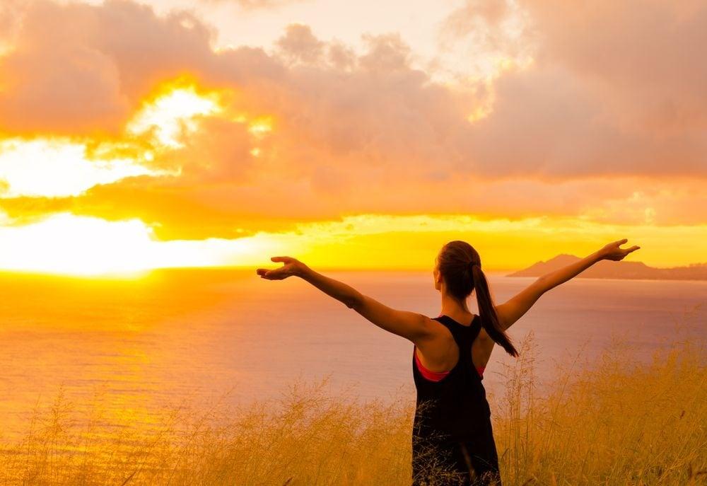 Woman enjoying with sunset