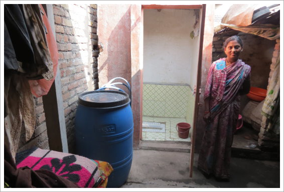 Woman next to toilet stall||||