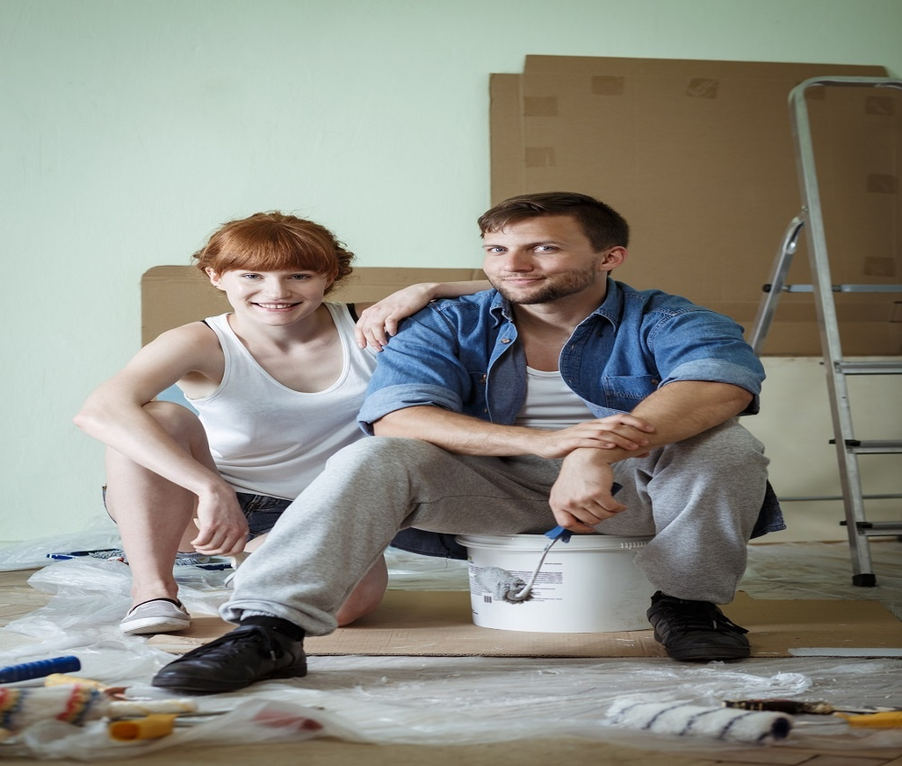 Couple Painting Their Own Home