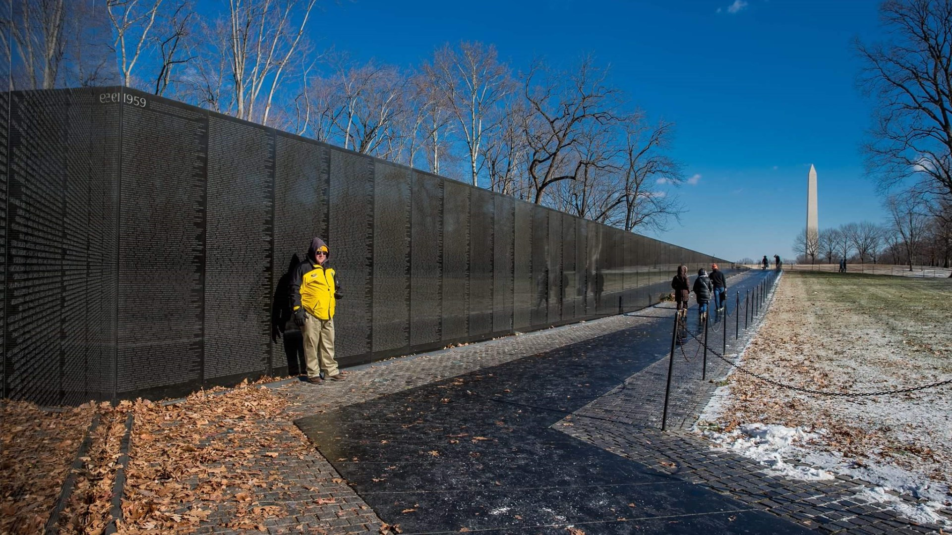 A volunteer stands vigil at Vietnam Memorial