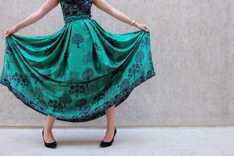 Woman Wearing Green And Black Sleeveless Dress