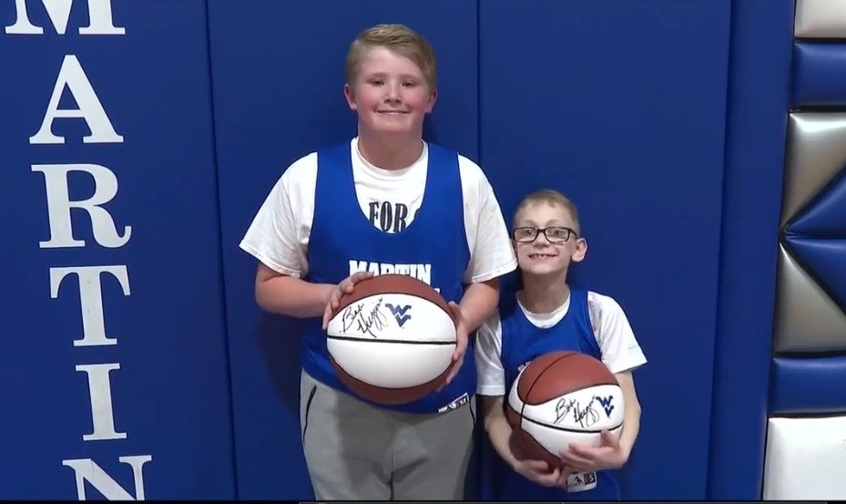 Signed Basketballs  Greyson Board and Austin Jenkins display the basketballs that were signed by WVU coach Bob Huggins and delivered to Martin School last week. Greyson helped Austin score a basket in the county tournament game on March 6 against Kanawha and the moment was captured on a video which went viral, seen by millions and played on virtually every TV show and station in America. Austin was born with cerebral palsy. The video can be seen on our facebook page.
