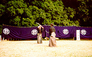 1992. Meiji Shrine. Sato Shimeo Sensei (L) and Suzuki Kunio Sensei (R) performing Kumitachi at the annual Budo exhibition sponsored by the Nippon Kobudo Shinkokai.