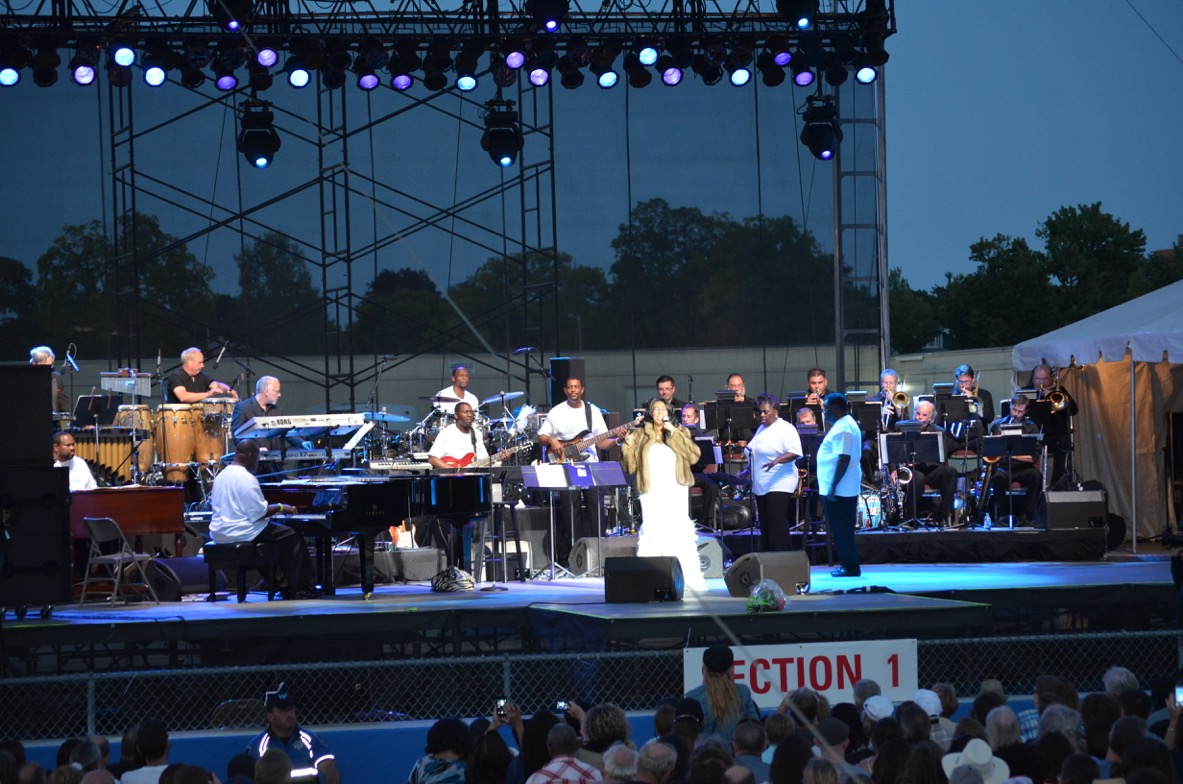 Eric Schoor (sax), Matt Anton (tpt), Kurt Cowling (pno) of Platinum and Kyle Samuelson (bone) of North Coast Orchestra performing with The Queen of Soul, Aretha Franklin.