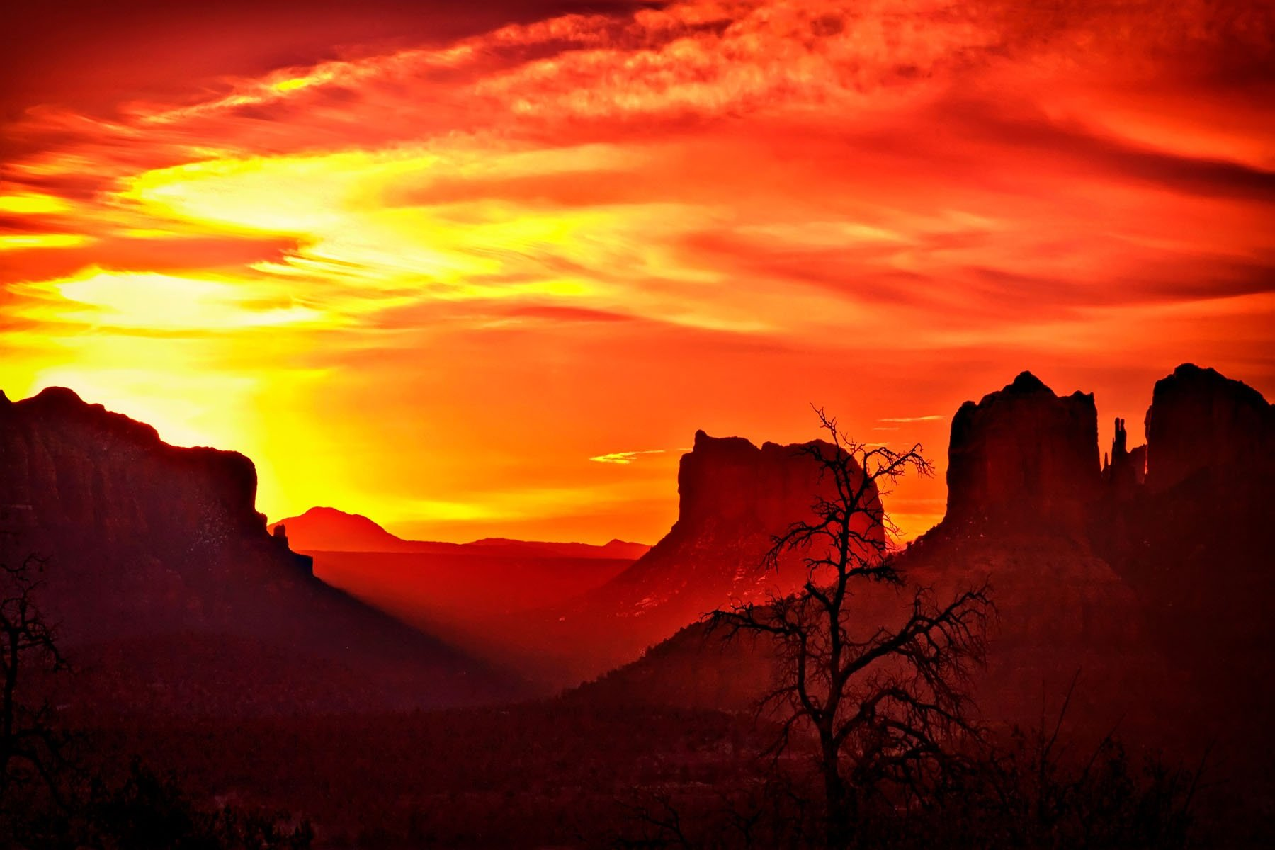 SEDONA SUNRISE - This was real luck. We had no plans to be in Sedona, but our route took us close enough we decided to spend the night there. We got an early start the next morning, and this was our reward.