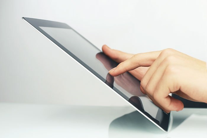 Person holding a tablet