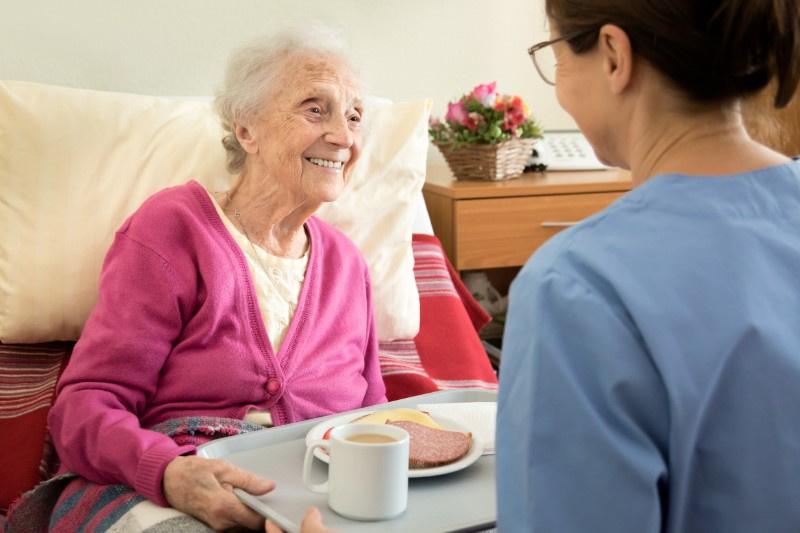 Home caregiver with senior woman