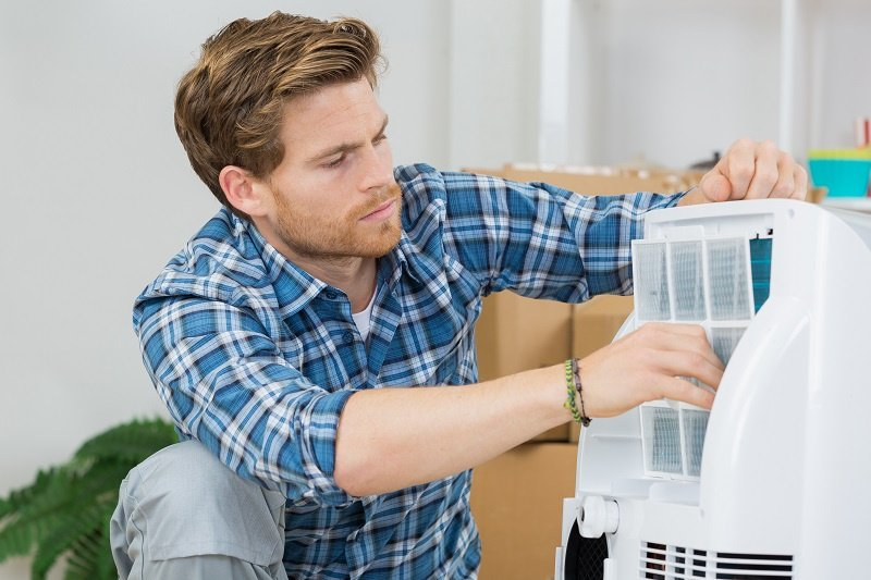 Technician Performing Air Conditioning Service in Acworth