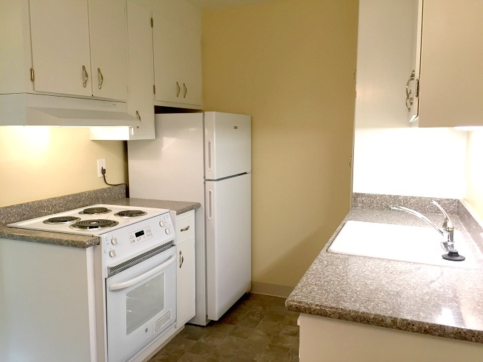 The kitchen has granite counter tops and under-cabinet lighting
