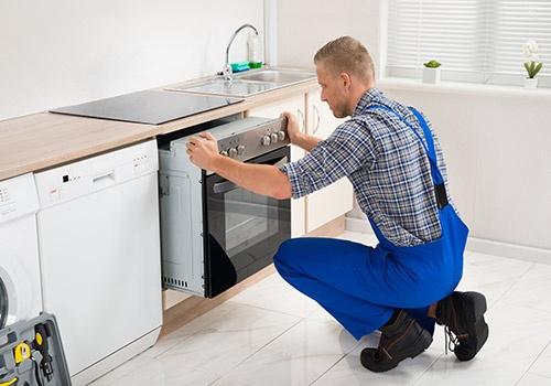 Repairman Repairing Oven