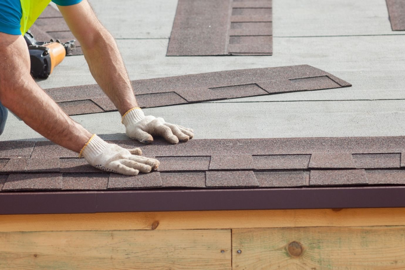 Roofer builder installing roof shingles