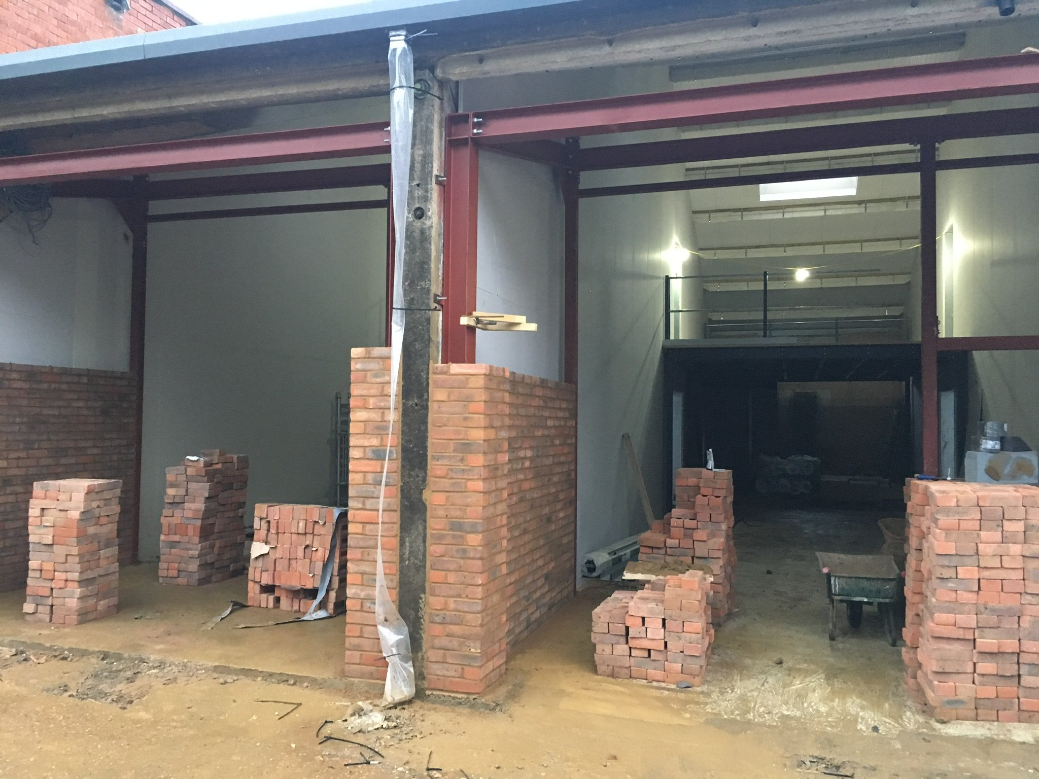 """Bricks were chosen to cover the steel work and make an attractive and durable entrance to each unit.  Bricks would create the look  we wanted for """"The Old Print Works"""""""
