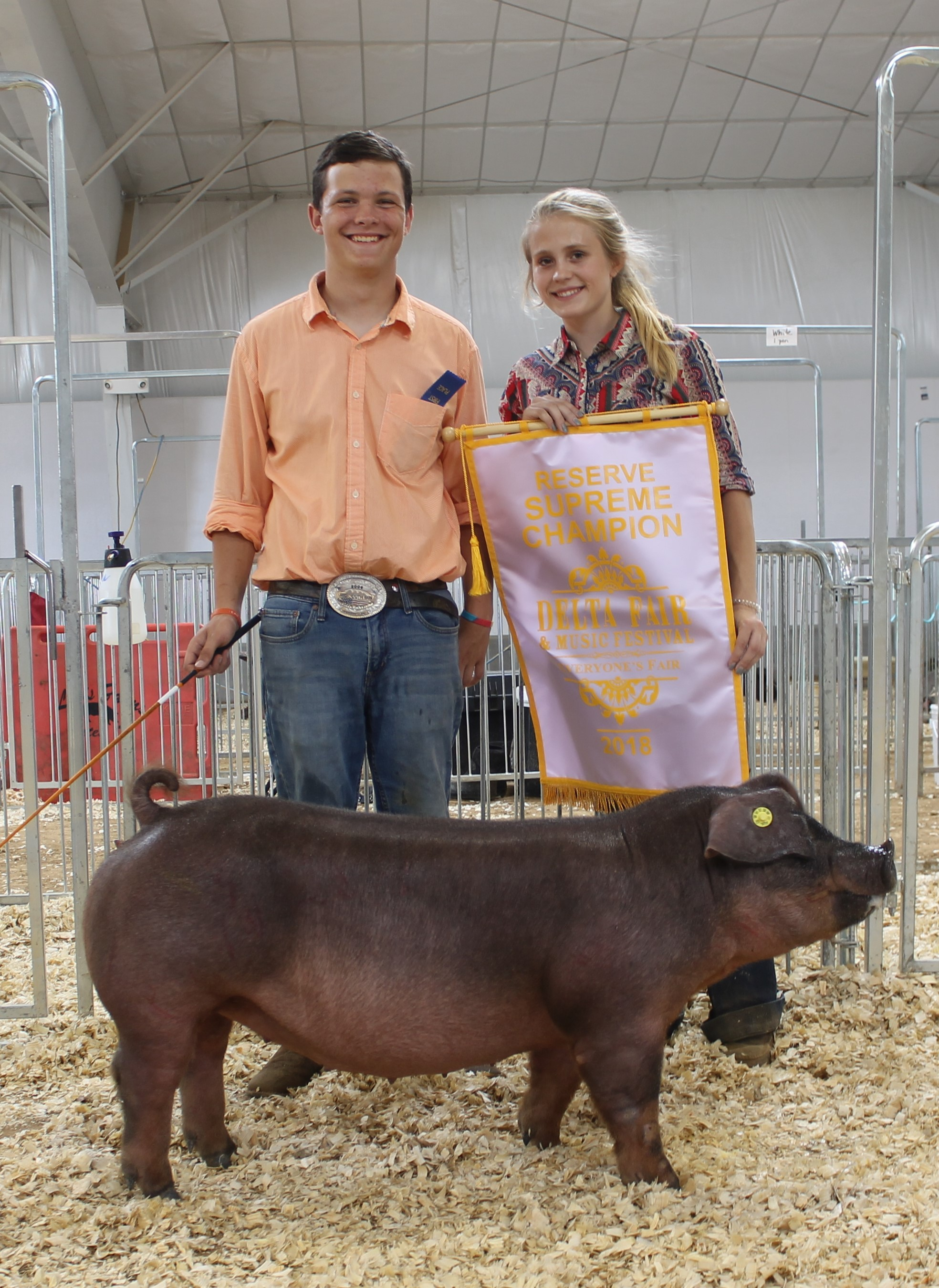 Hunter Curland and Hailey Azbill 2018 Delta Fair & Music Festival Reserve Supreme Champion Overall Champion Duroc Gilt