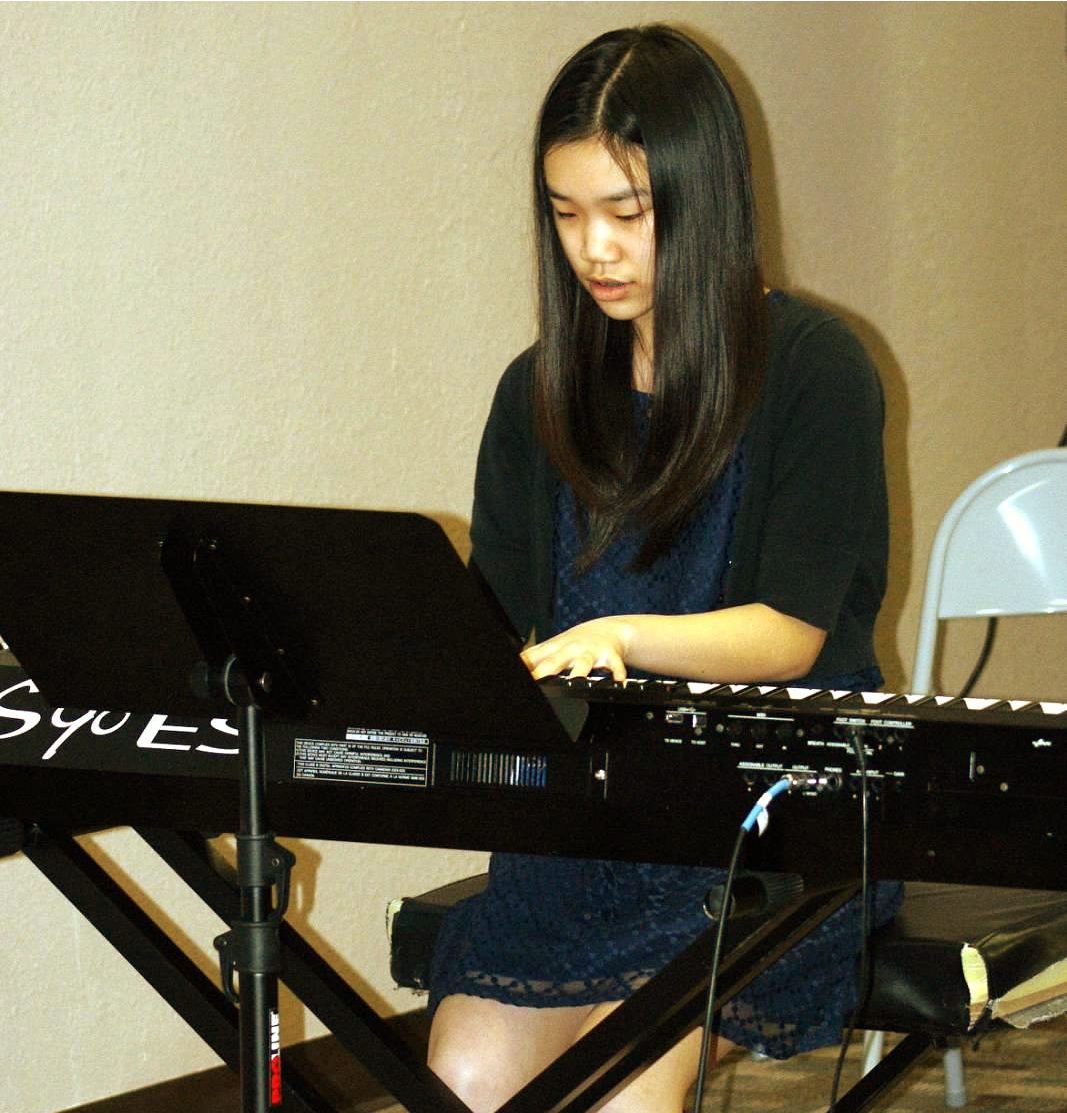 Asian Girl Playing the Piano