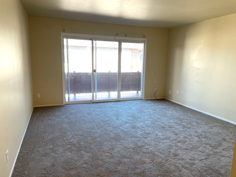 The family room with new carpet , and a private balcony that overlooks the courtyard.
