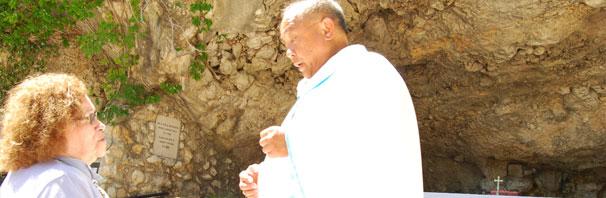 "Priest Celebrating Mass at ""Lil Lourdes"" on way to Medjugorje"