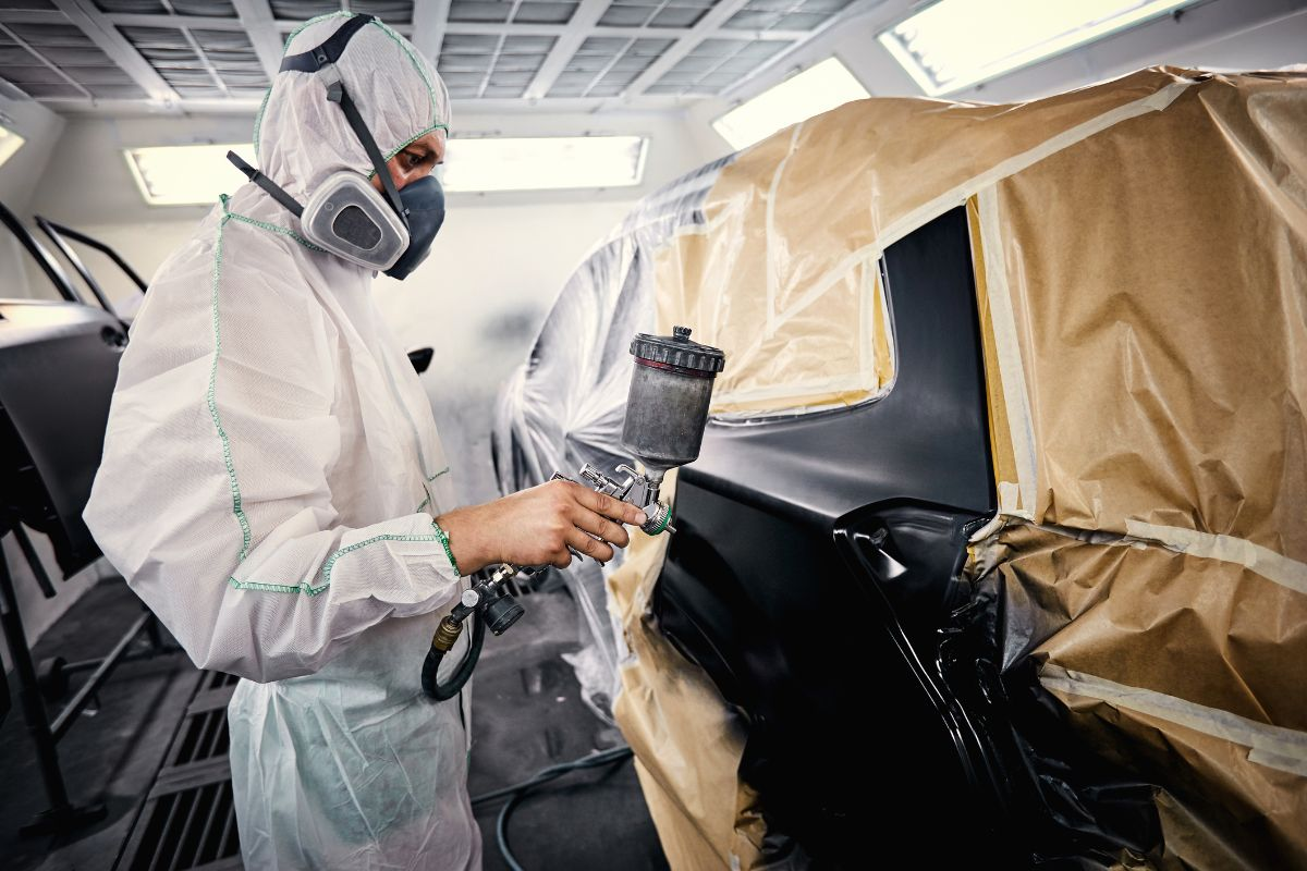 Painting the car in black color in the paint chamber
