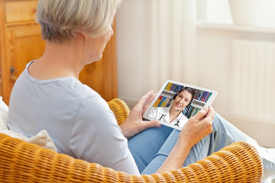 Elderly Woman Using Telemedicine on iPad
