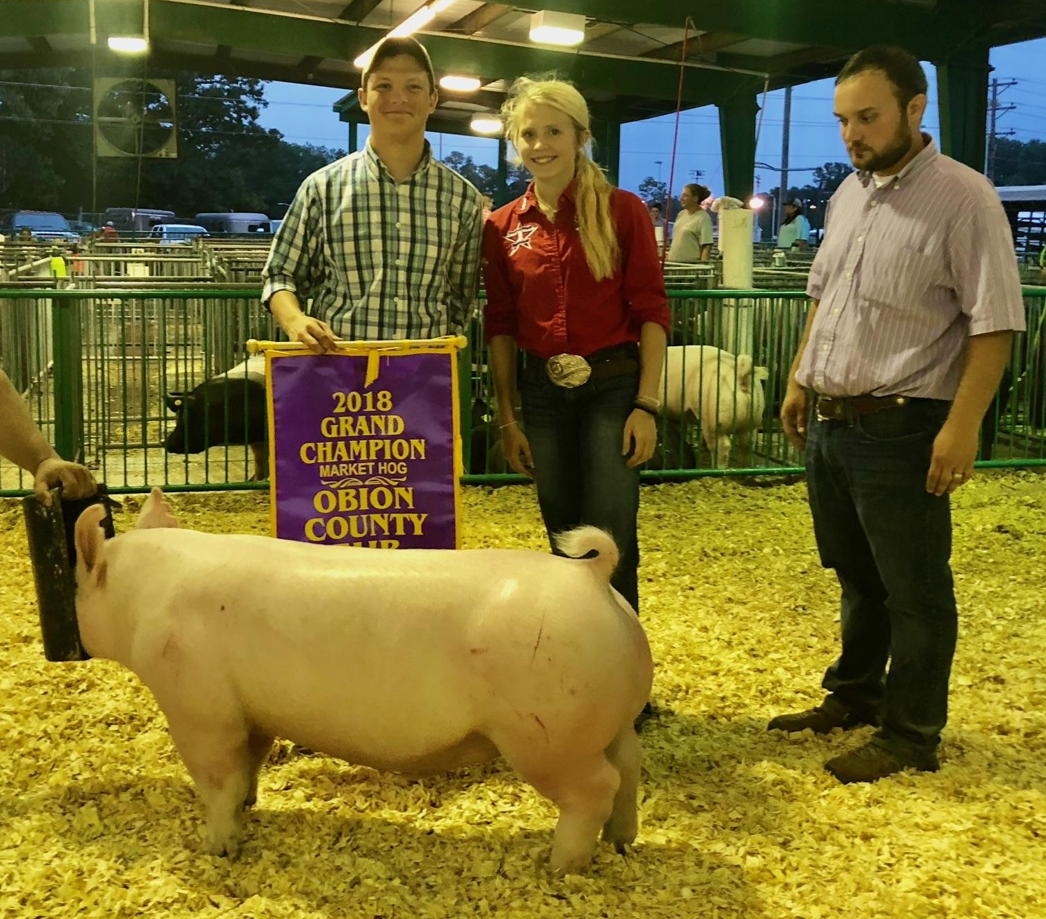 Hunter Curland and Hailey Azbill 2018 Obion County Fair Champion Market Hog