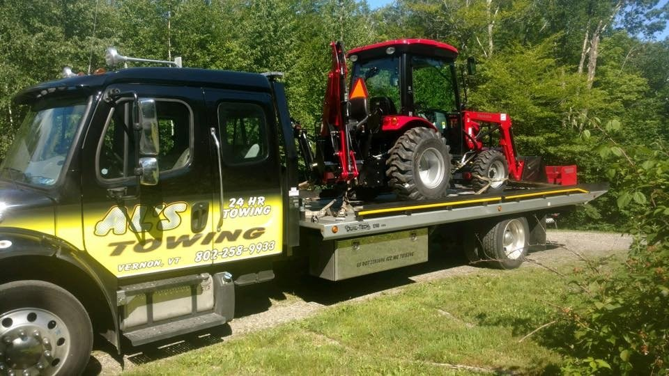 Our new truck delivering a new tractor for a Gary's Power Equipment customer. We do much more than tow broken down vehicles! Call us the next time you need a heavy or large item moved!