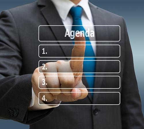 Hand Touching Virtual Panel of Agenda List