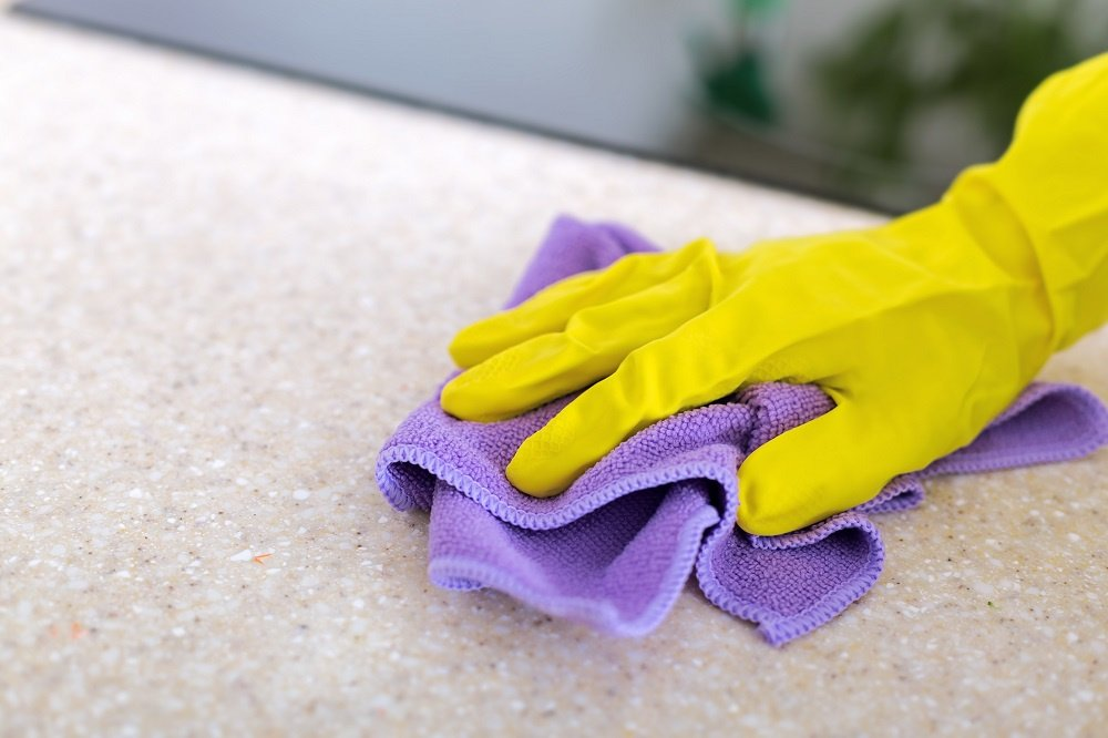 Wiping Counter with Microfiber Cloth and Yellow Rubber Glove On