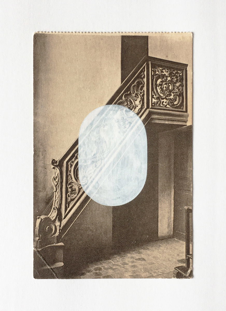 An antique postcard of an ornate staircase, with a centered white oval added.