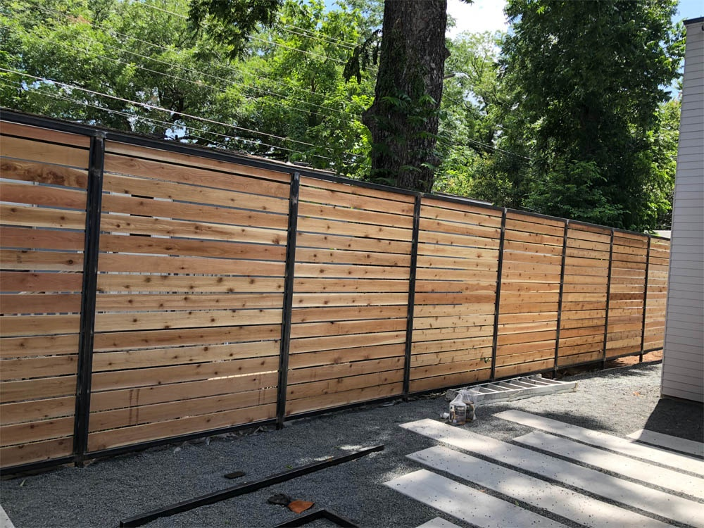 https://0201.nccdn.net/4_2/000/000/087/05f/Steel-Wood-Fencing-1000x750.jpg